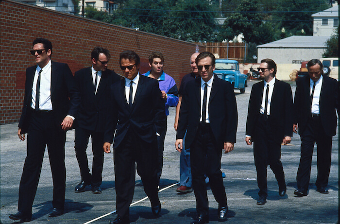 Michael Madsen, Quentin Tarantino, Harvey Keitel, Chris Penn, Lawrence Tierney, Tim Roth, Steve Buscemi, and Edward Bunker in Quentin Tarantino's RESERVOIR DOGS (1992). Image courtesy of Park Circus/Miramax. Playing Friday, May 19 through Thursday, June 1.